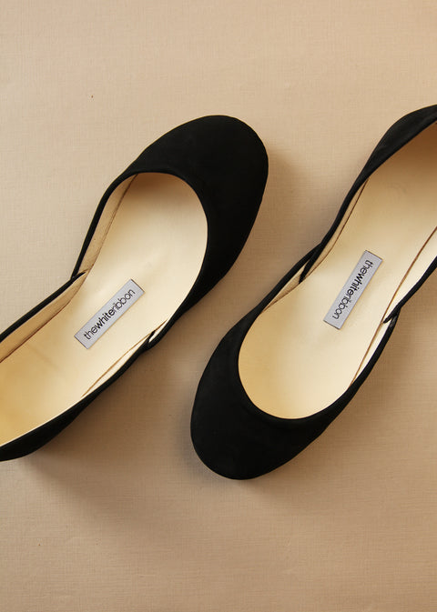 black nubuck ballerinas from above with white background