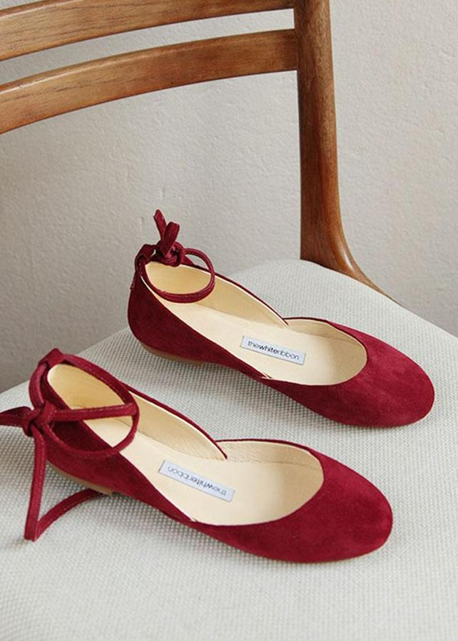 Cherry red suede ballet flats with long leather ankle ribbons in sideview