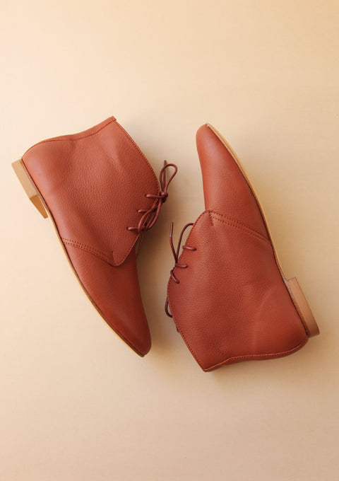 brown smooth leather ankle boots with matching laces in side view