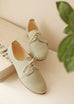 pastel mint shade smooth leather saddle shoes in top view