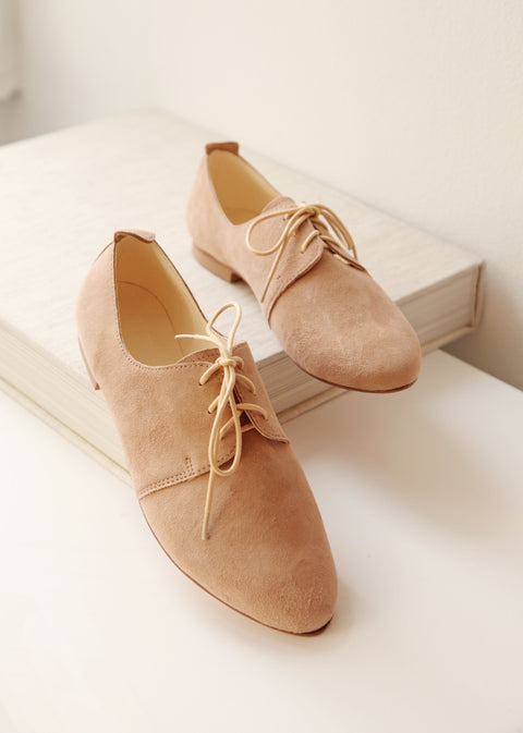 beige nubuk leather oxford shoes seen from front top on white blackground