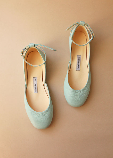 textured leather ballerinas in mint colour with matching ankle straps shown from top