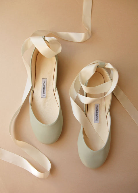 light pastel mint shade smoothe leather ballet flats with cream satin ribbons in top view
