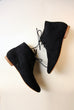 black sparkling ankle boots shown from the sides with white blackground
