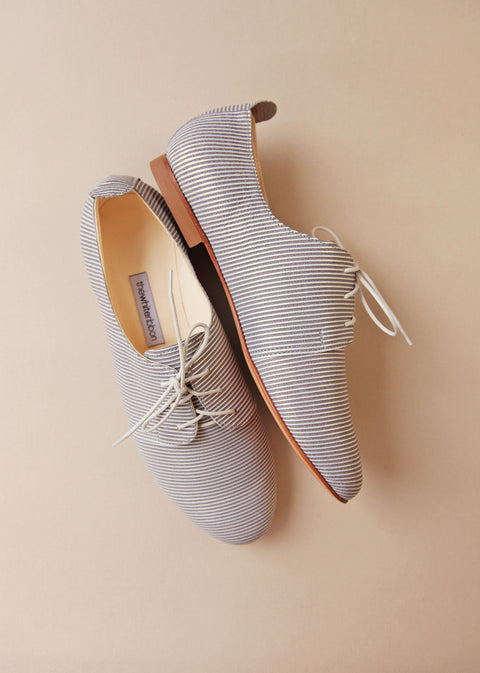 striped light blue smooth leather oxfords from side and top view
