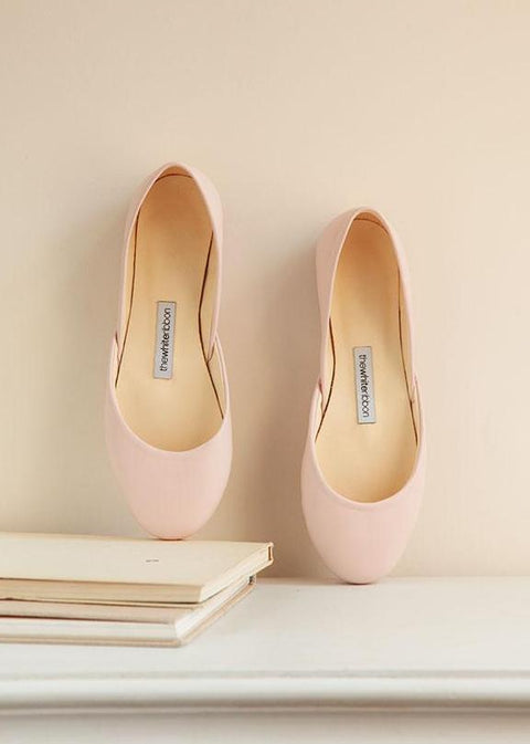 leather ballerinas in blush color shown from the top with white background