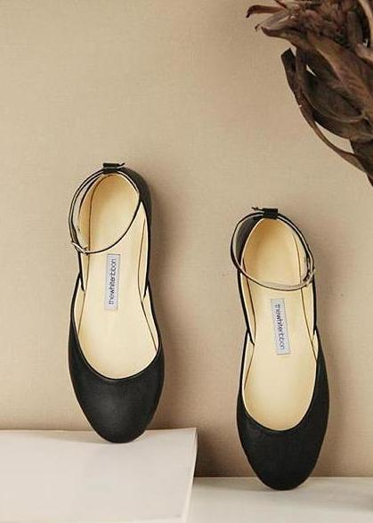 black leather ballet flats with matching ankle straps from top