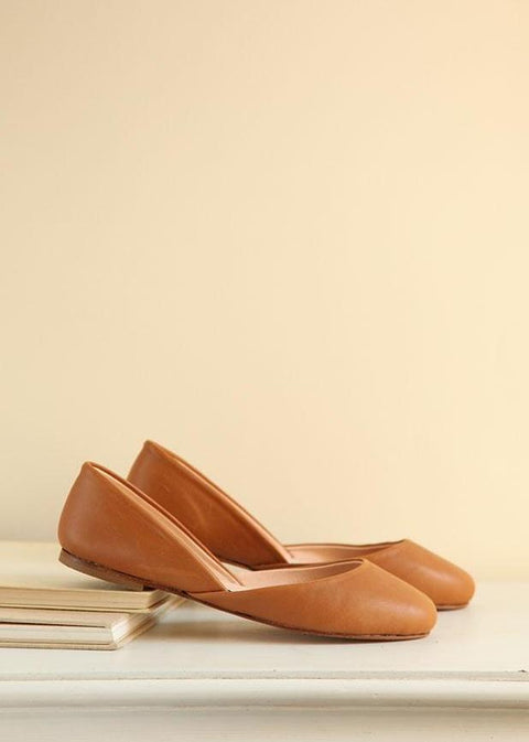 cognac brown smooth leather ballet flats in side view
