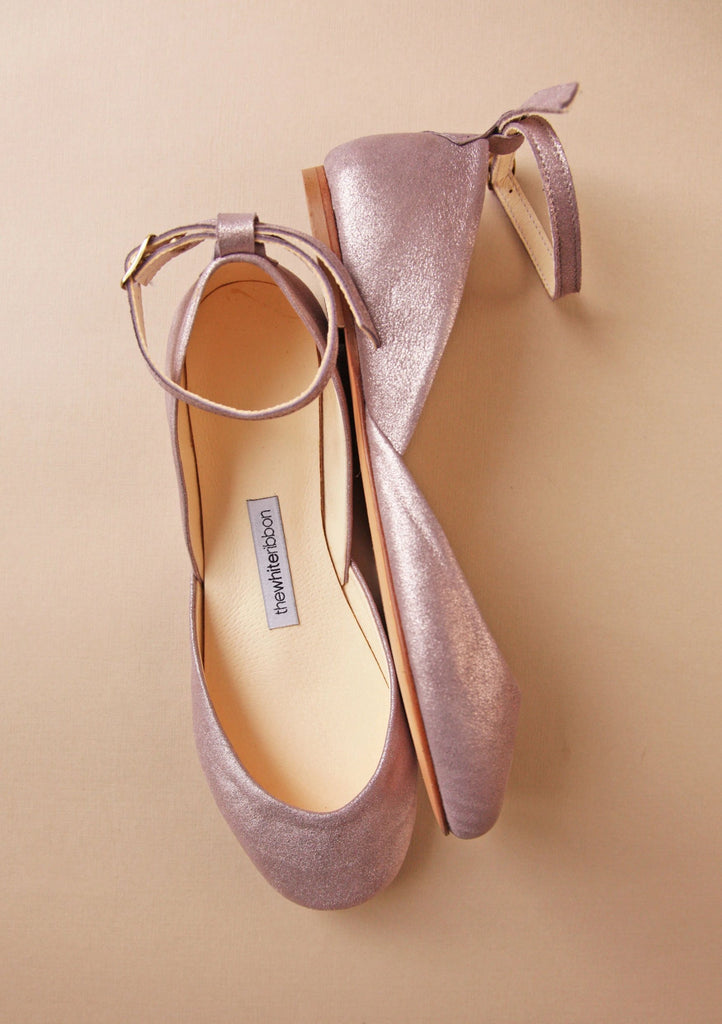 side and top view of lavender gold coloured ballerinas with matching ankle straps on cream background