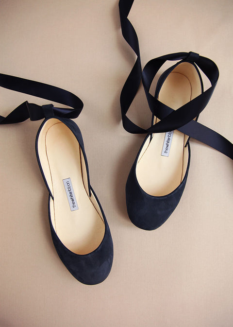 dark blue soft leather ballet flats with matching satin ribbons in top view