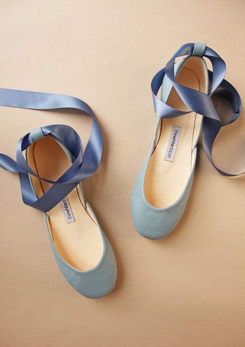 light blue shade smooth leather ballet flts with matching satin ribbons in top view