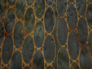 green background  with brown ovals batik