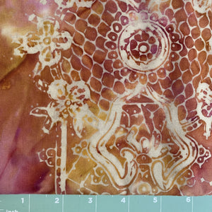 Maroon, gold background with white lace print in batik