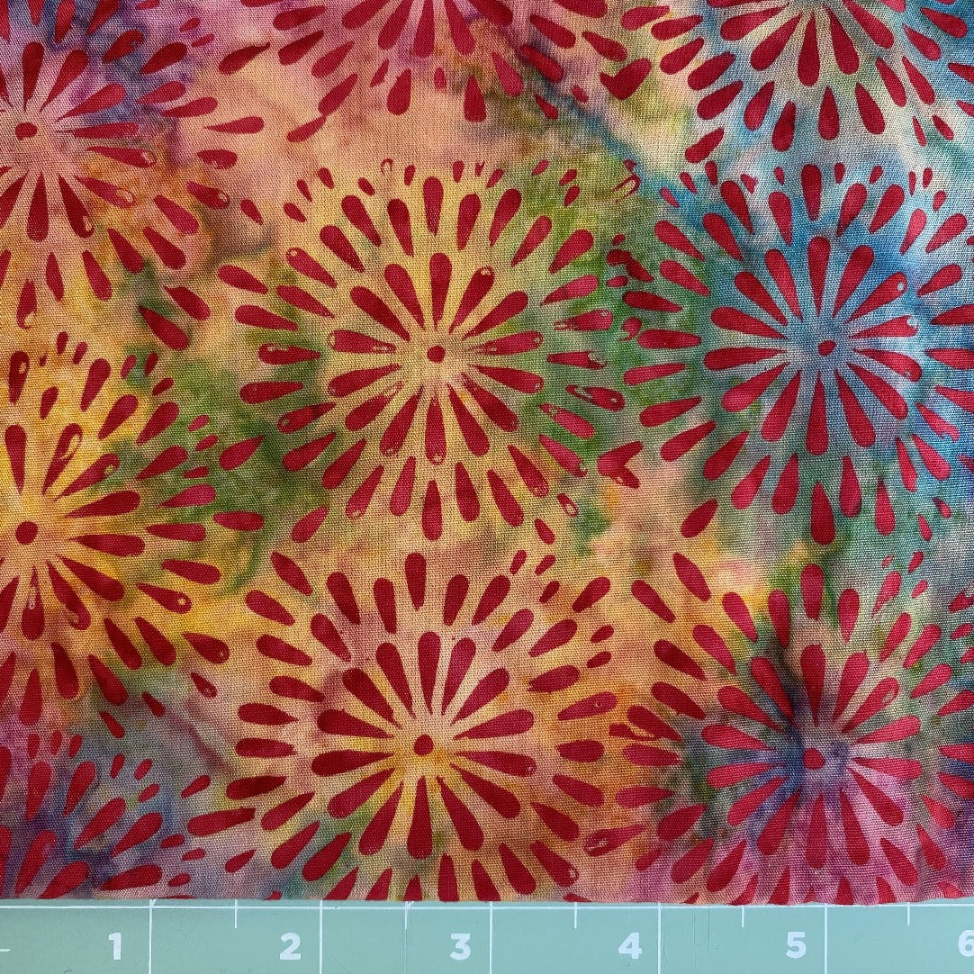 multi color back ground with a red star burst print