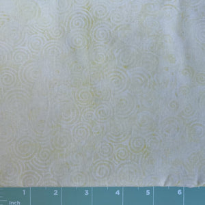 pale yellow background with swirl print batik