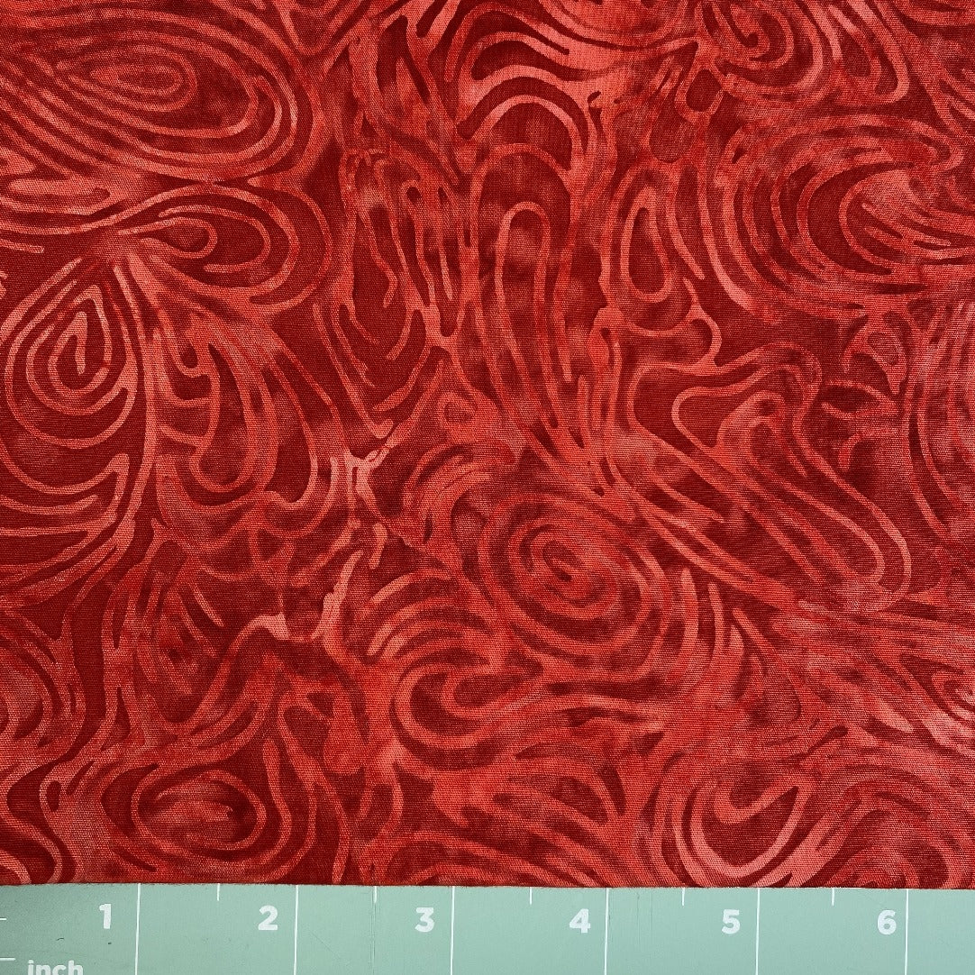 red tone on tone with wavy lines batik print