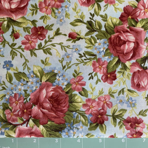 rose print on a modeled background of blue by Marti Michell