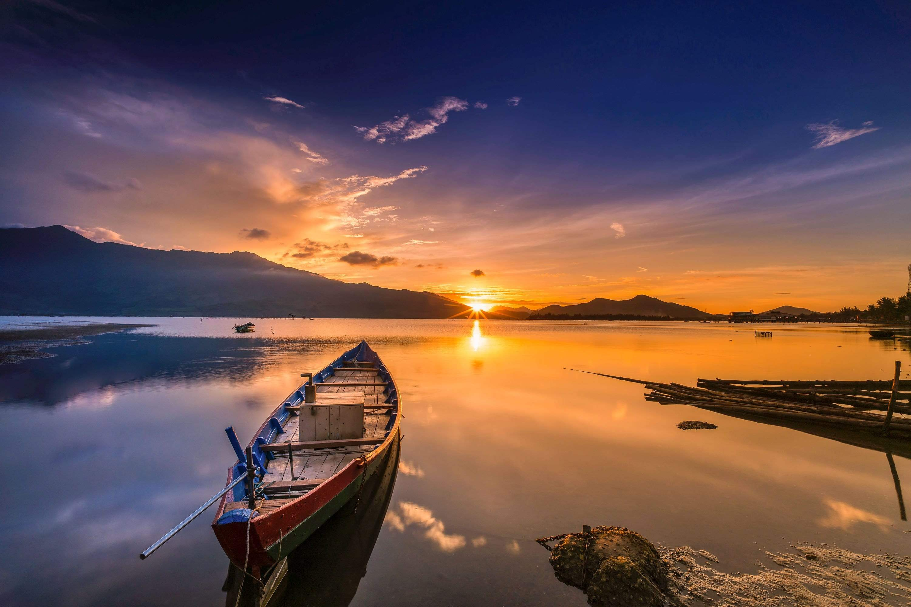 Boat overlooking water with sunset
