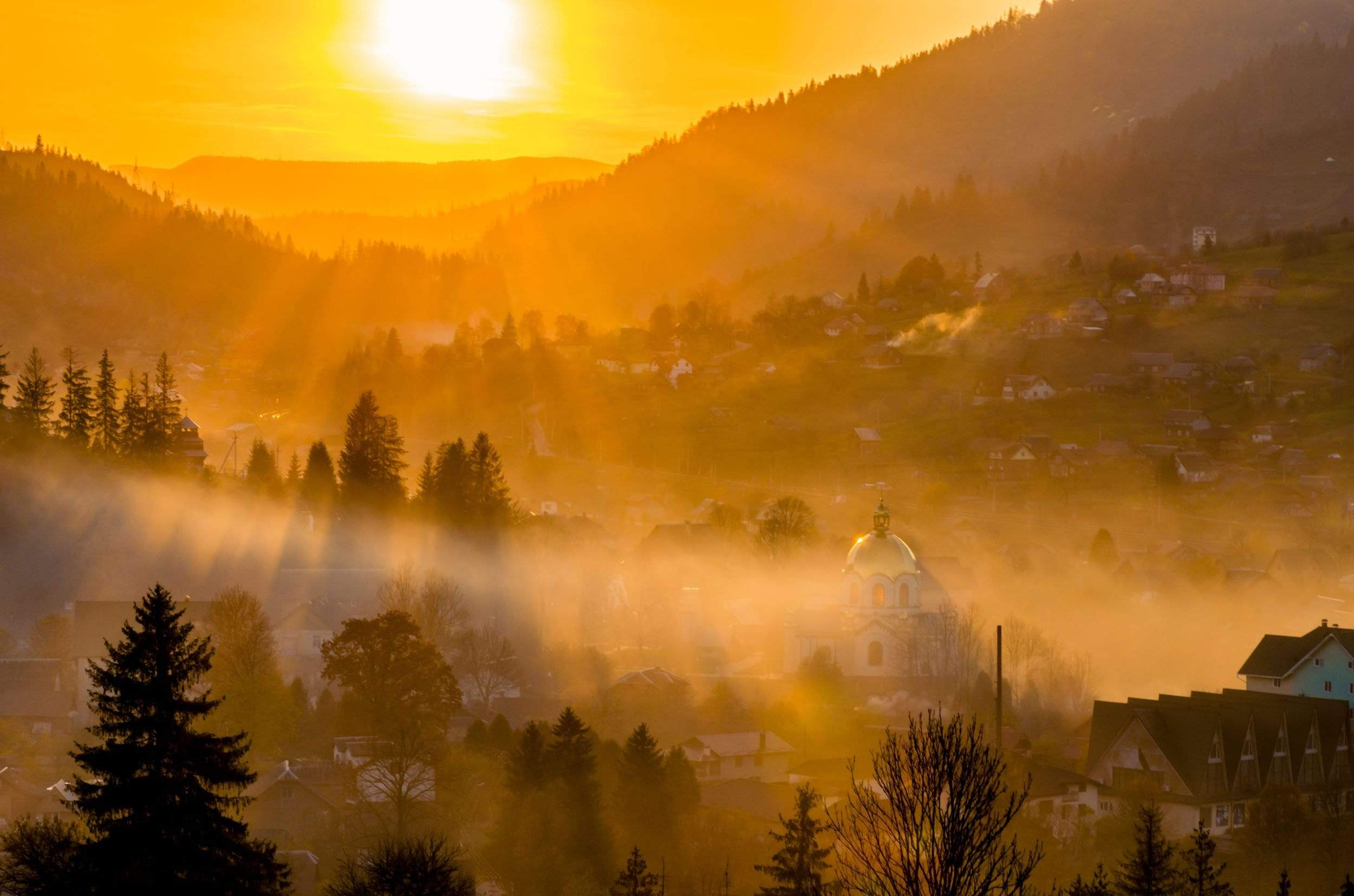 Sunset of misty small town