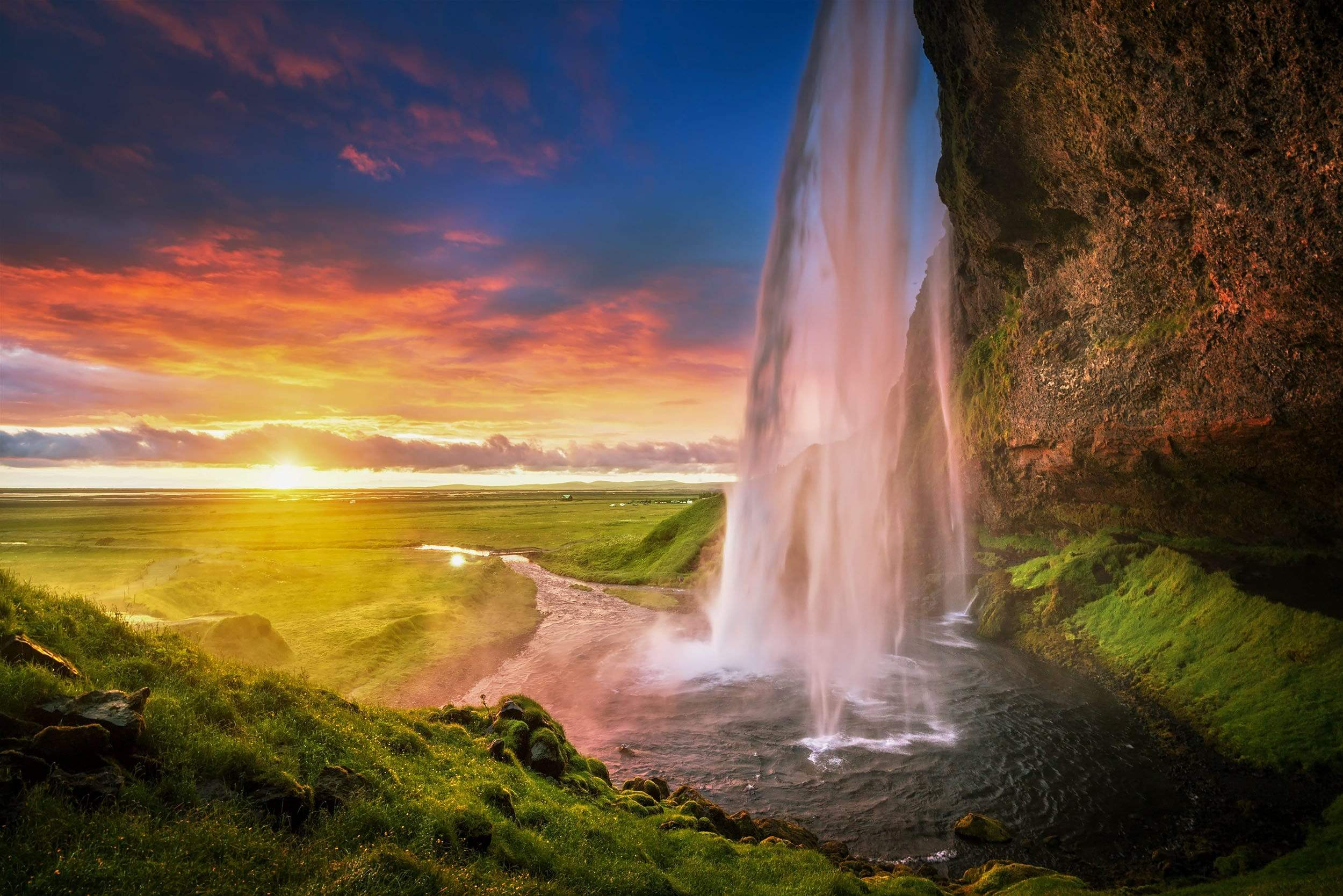 Waterfall flowing into River Sunset