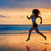 Woman running on beach waves and sunset