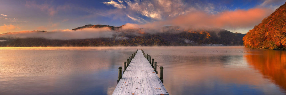 Wooden dock over lake fall colours sunset