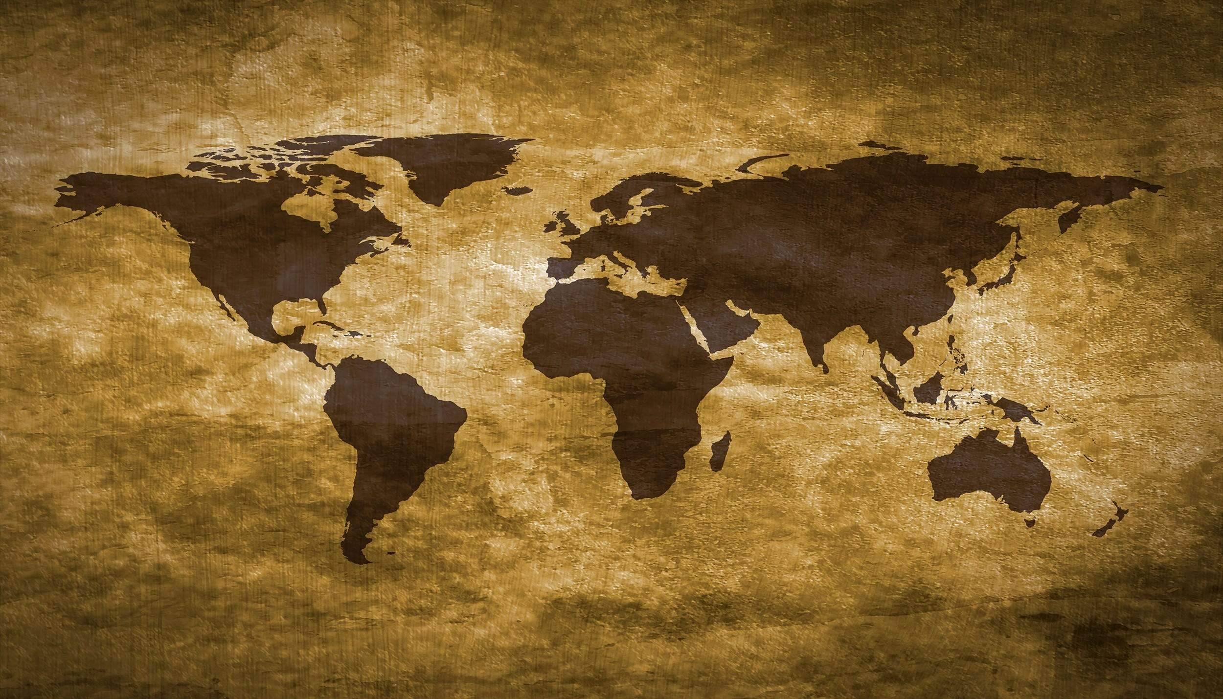 World Map Golden colour on textured paper