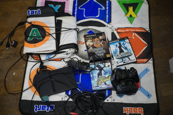Huge ps2 + DDR mat + games bundle