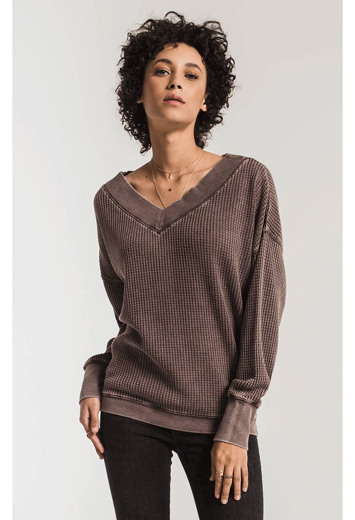 The Emilia Thermal Top-Reddened Brown