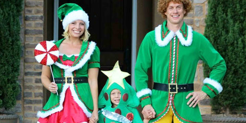 family in green elves costumes