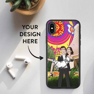 Succulent, airpods and iPhone XS Max lying on the table. Smartphone has a custom design biodegradable case on it. Design contains an illustration of a couple turned into Rick and Morty cartoon characters. Text on the image says: Your Design Here. An arrow is pointing from the text to the phone.