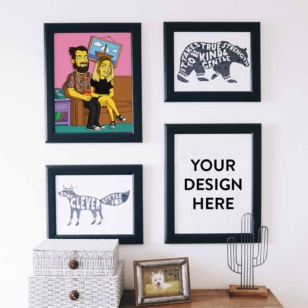 A modern minimalistic interior with four frames on the wall. One of the frames contains a personalized Simpsons style cartoon illustration. The other frame says: Your design here.