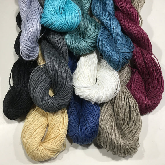 This is a 4 ply, light weight yarn that is a 100% linen in bleached white, grey, natural, medium blue, dusty green, teal, black, turquoise or ice blue.
