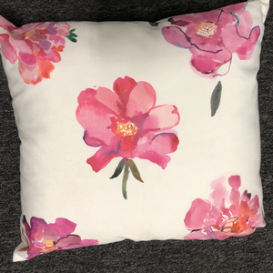 white pillow pink flowers
