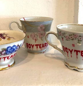 Boy tears flower mug