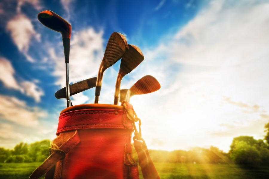 Golf equipment. Professional golf clubs in a leather baggage at