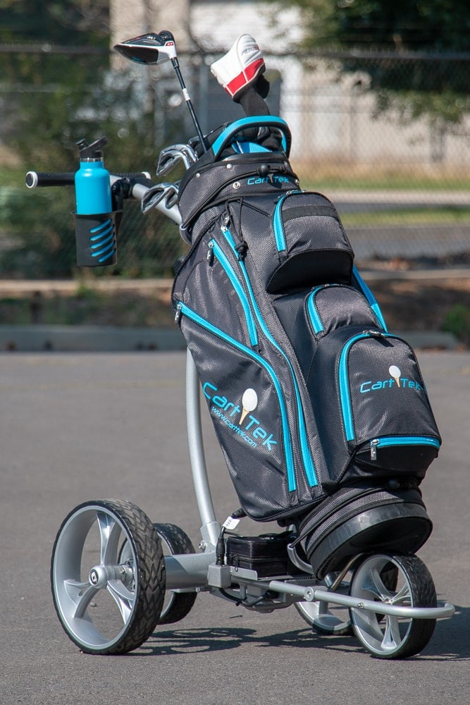 Cart Tek GRI-1500Li remote controlled battery powered golf trolley with new large plastic drink holder and blue golf bag.
