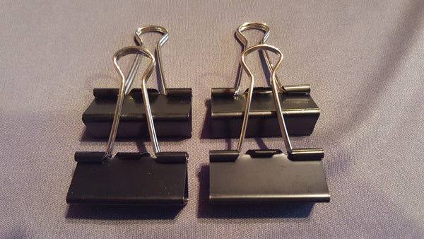 Binder Clips to hold bag.