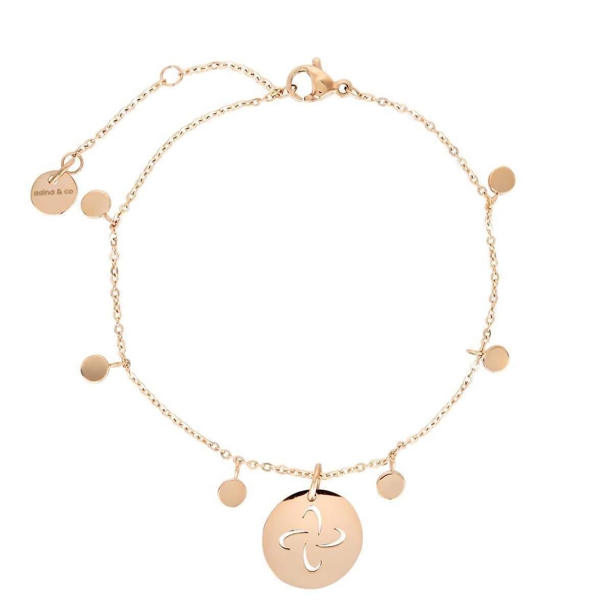 Dainty Bracelet with playful discs and Tabono Symbol Charm