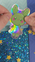 "Load and play video in Gallery viewer, 3"" Alien Bun Holographic Sticker"