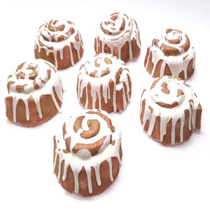 Each Cinnamon Roll Bath Bomb weighs 4.6 ounces. Each one is drizzled with a Cocoa Butter and Baby Foam ( a very mild bubbling additive)