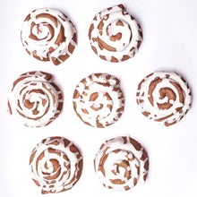Load image into Gallery viewer, Top view of 7 scrumptious Cinnamon Rolls- Except these are Bath Bombs that are scented with mouthwatering Maple Cream blend, and create a fantastic color show.