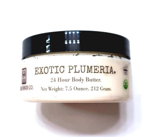 A close up of Exotic Plumeria Emulsified Body Butter on its side. Vegan and organic this is the Classic Body Butter. It weighs 7.5 ounces.