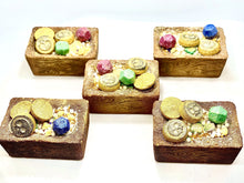 Load image into Gallery viewer, A top view image of five Treasure Chest Bath Bombs filled with Bath Treasure containing Mini Mictlan Medallions, Ruby, Emerald and Sapphire Gems with Sugar Crystals and Pearls atop a hidden color embed surprise.  Each Treasure Chest Bath Bomb is hand painted and airbrushed.