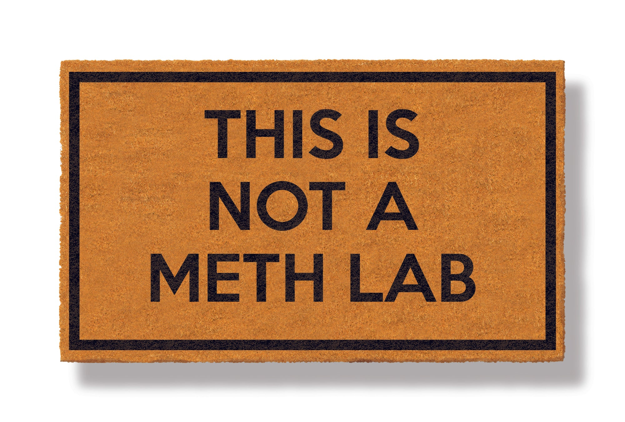 This coir welcome mat is a funny doormat on a white background with a drop shadow. The brown doormat has a black border and has black centered text that reads This Is Not A Meth Lab.