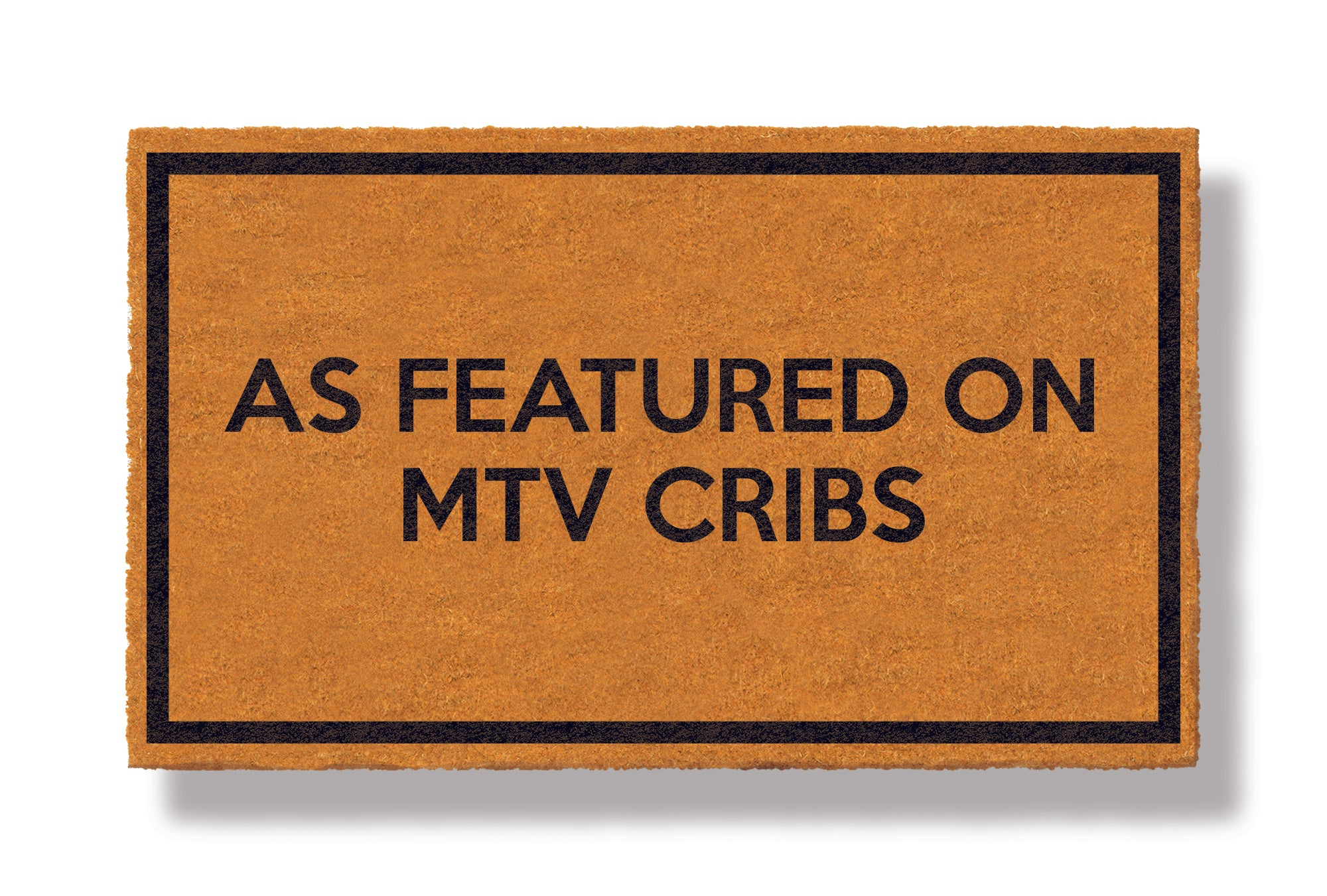 This coir welcome mat is a funny doormat on a white background with a drop shadow. The brown doormat has a black border and has black centered text that reads As Featured on MTV Cribs.