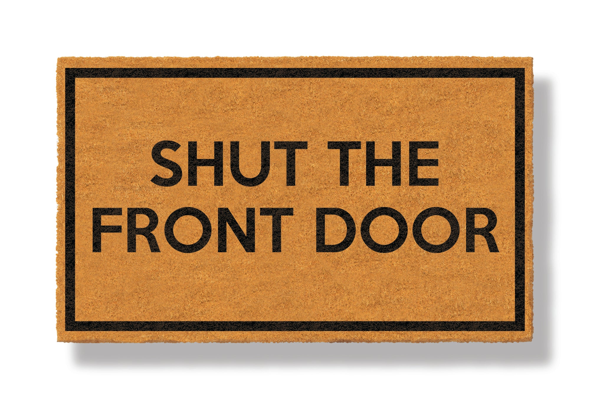 This coir welcome mat is a funny doormat on a white background with a drop shadow. The brown doormat has a black border and has black centered text that reads Shut The Front Door.