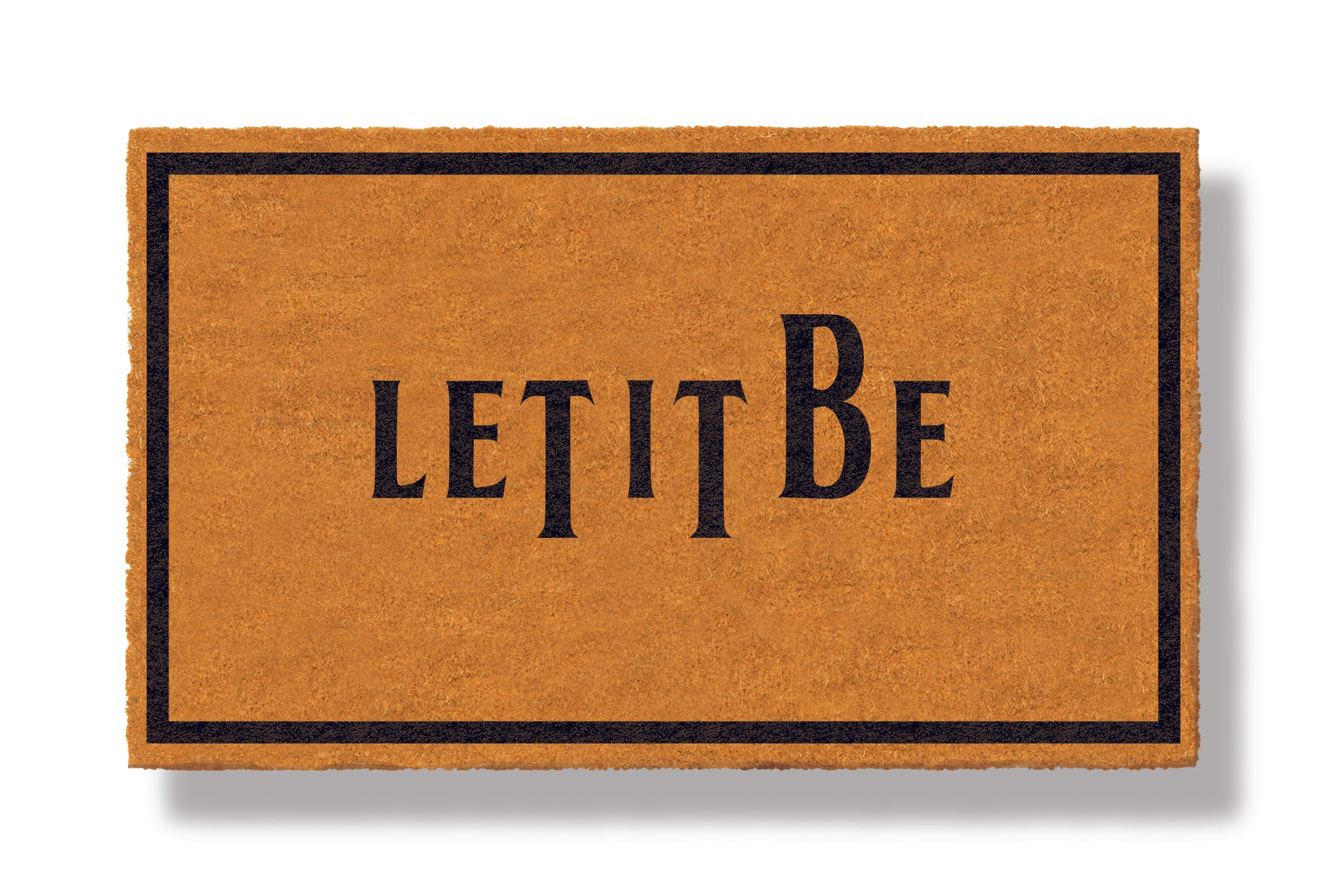 This coir welcome mat is a funny doormat on a white background with a drop shadow. The brown doormat has a black border and has black centered text that reads Let It Be.