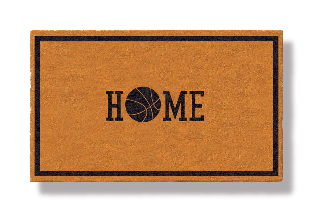 This coir welcome mat is a funny doormat on a white background with a drop shadow. The brown doormat has a black border and has black centered text that reads Home.