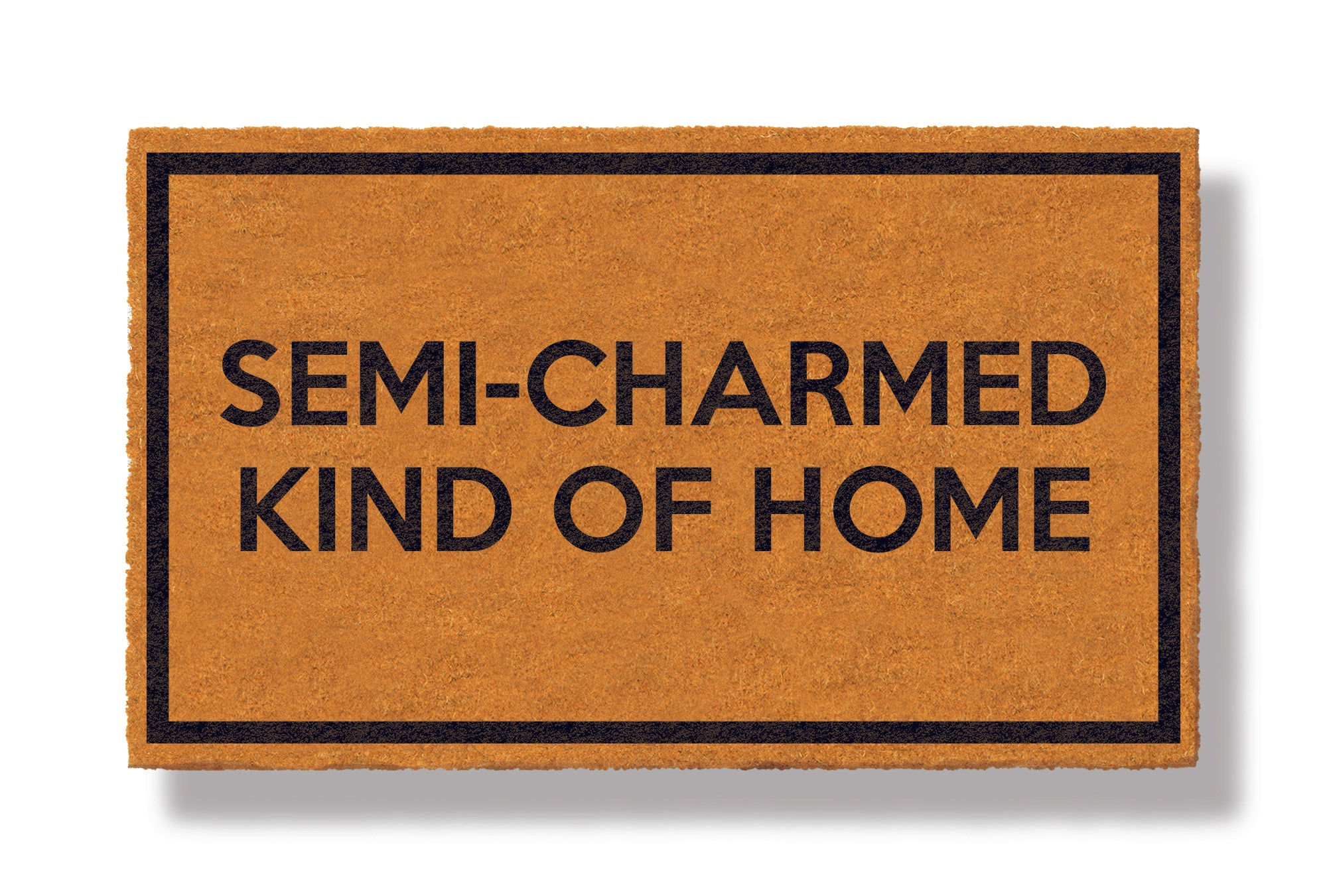 This coir welcome mat is a funny doormat on a white background with a drop shadow. The brown doormat has a black border and has black centered text that reads Semi-Charmed Kind Of Home.
